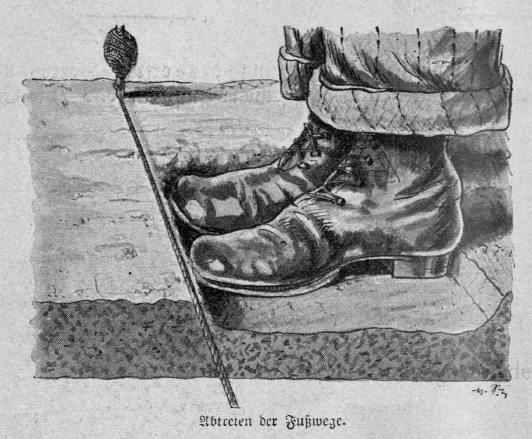 Das Bild zeigt Füße eines Menschen beim Abtreten von Wegen zwischen den Beeten.